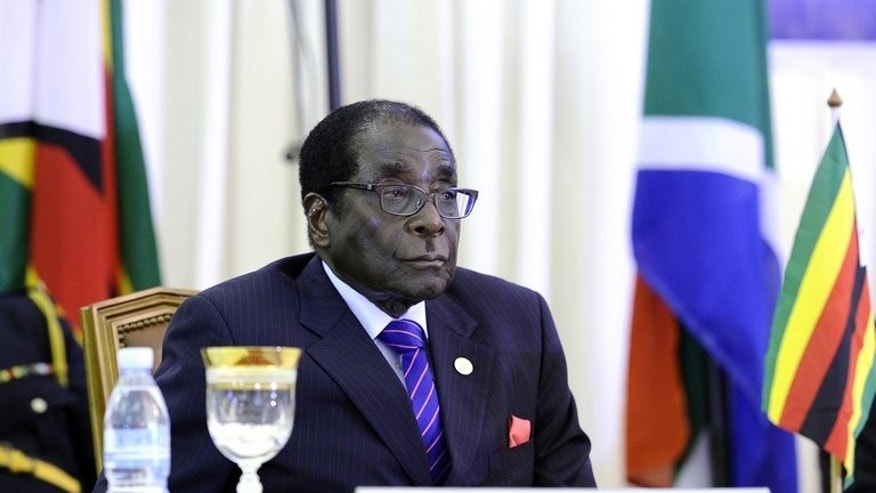 Zimbabwean President Robert Mugabe attends the opening ceremony of the 31st SADC summit on August 17, 2011 in Luanda, Angola. Mugabe has become Zimbabwe's sole law-making authority until the next elections are held following the automatic dissolution of parliament, his justice minister told state media.