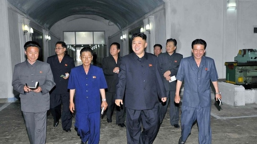 North Korean leader Kim Jong-Un inspects a factory, in a picture released by state media on June 29, 2013. North Korea has deployed new rocket launchers along its border capable of hitting targets beyond Seoul, a report said.