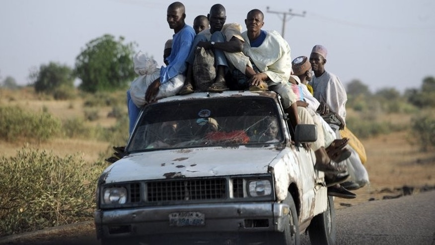 "Nigerians who fled their homes return on April 30, 2013 after Islamists clashed with soldiers in Baga town. Soldiers fired wildly ""at anybody in sight"" during the deadly April incident in the town, a police report cited by the country's Human Rights Commission said."