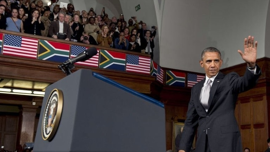 US President Barack Obama waves after delivering a speech on US-Africa relations at the University of Cape Town in Cape Town on June 30, 2013.