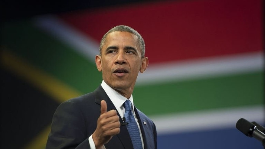 US President Barack Obama speaks during a meeting at the University of Johannesburg Soweto in Johannesburg, South Africa, June 28, 2013. Obama will host a landmark summit of leaders from across sub-Saharan Africa next year, the White House says, jostling with China for economic influence in the region.