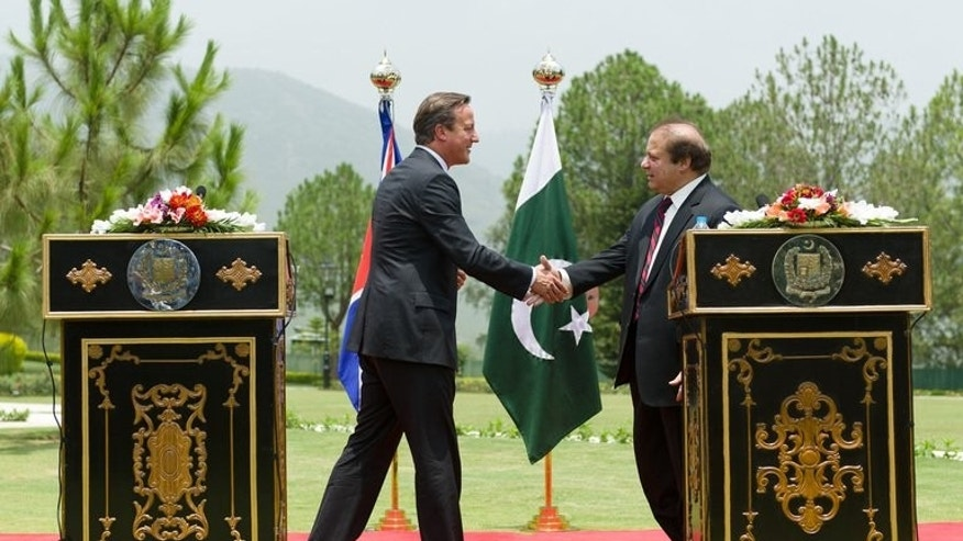 David Cameron (left) shakes hands with Nawaz Sharif at the prime minister's house in Islamabad on Sunday. Cameron flew to Pakistan from Afghanistan, where he joined an international push to revive peace efforts that recently collapsed in ignominy after the insurgents opened an office in the Qatari capital Doha.