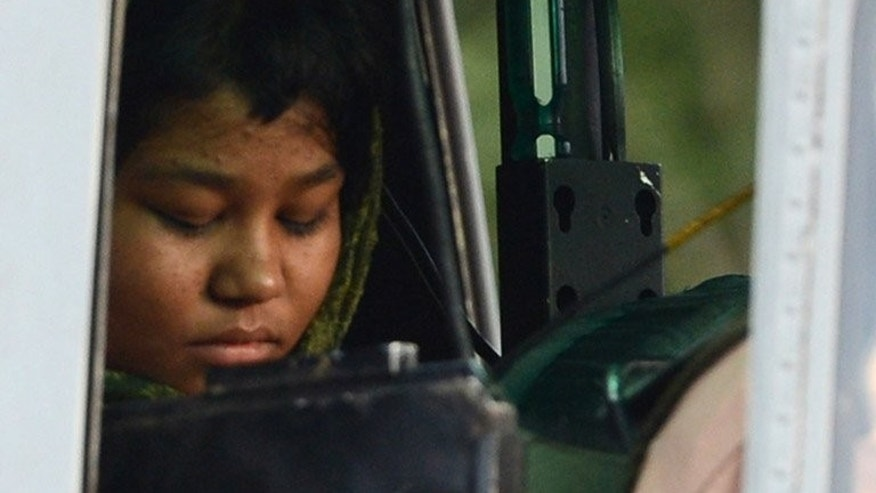 Rimsha Masih sits in helicopter after her release from jail in Rawalpindi last September. A Pakistani Christian girl who was arrested for alleged blasphemy last year and forced into hiding for fear of her life has moved to Canada, an activist said Sunday.