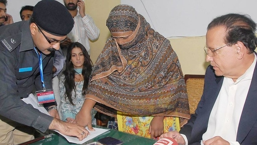 Asia Bibi puts a thumbprint on her appeal papers against a death sentence in Sheikhupura prison in November 2010. Asia Bibi, a Christian mother of five, remains in prison after being sentenced to death in November 2010 after other women claimed she made derogatory remarks about the Prophet Mohammed.