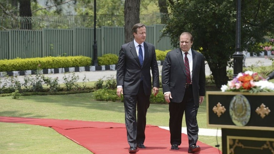 British Prime Minister David Cameron (left) arrives with his Pakistani counterpart Nawaz Sharif for a news conference at the Prime Minister's house in Islamabad on June 30, 2013. Pakistan assured Cameron it would promote peace efforts in neighbouring Afghanistan as the West pushes for talks with the Taliban ahead of NATO's withdrawal.