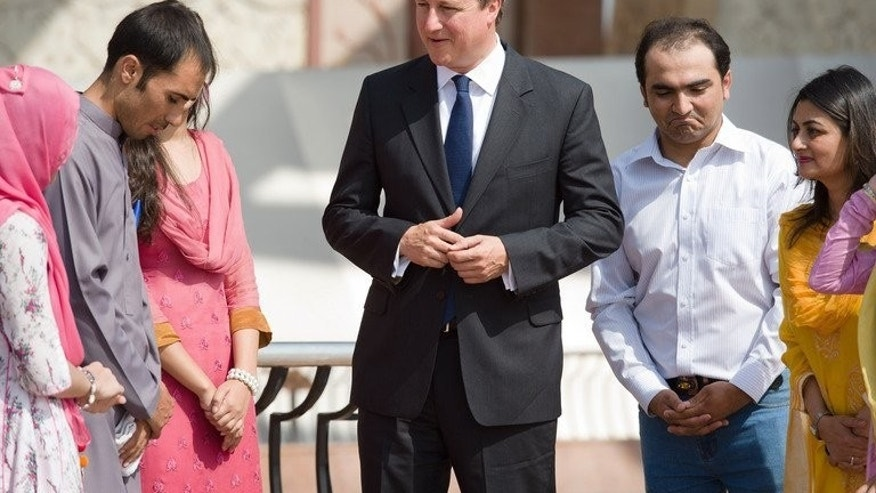 David Cameron (centre) meets British Council students at the National Monument in Islamabad on Sunday. Cameron is the first foreign government leader to visit Islamabad since Prime Minister Nawaz Sharif took office in June after winning landmark elections in May.