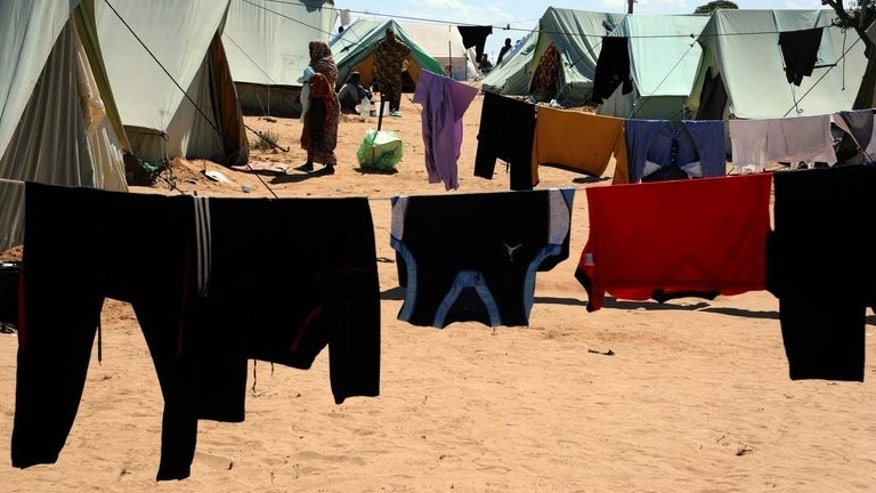A refugee who fled Libya walks at the Tunisian refugee camp of Choucha on March 18, 2011 in Ras Jdir. Several hundred people who had fled the 2011 Libya conflict have refused to leave the camp in southern Tunisia, which was due to be shut, blocking attempts to dismantle their tents, an AFP journalist reported.