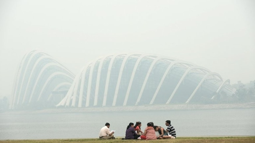 Singapore is shrouded in haze on June 20, 2013. The city-state's clean and green reputation has taken a hit from Indonesian forest fires and its standing as a corporate and expatriate haven could be hurt if the smog becomes an annual scourge, analysts warn.