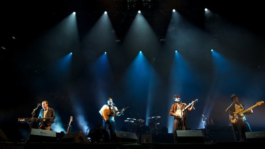 Headline band Mumford and Sons perform on the Pyramid Stage on the fifth day of the Glastonbury Festival of Contemporary Performing Arts, on June 30, 2013. The band delivered an energetic set despite bassist Ted Dwane having undergone brain surgery to remove a blood clot less than three weeks ago.