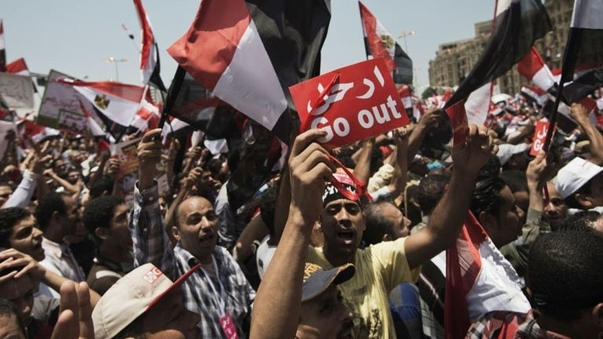 Egyptians rally against President Mohamed Morsi and the Muslim Brotherhood as thousands gather in Cairo's Tahrir square on June 30, 2013.