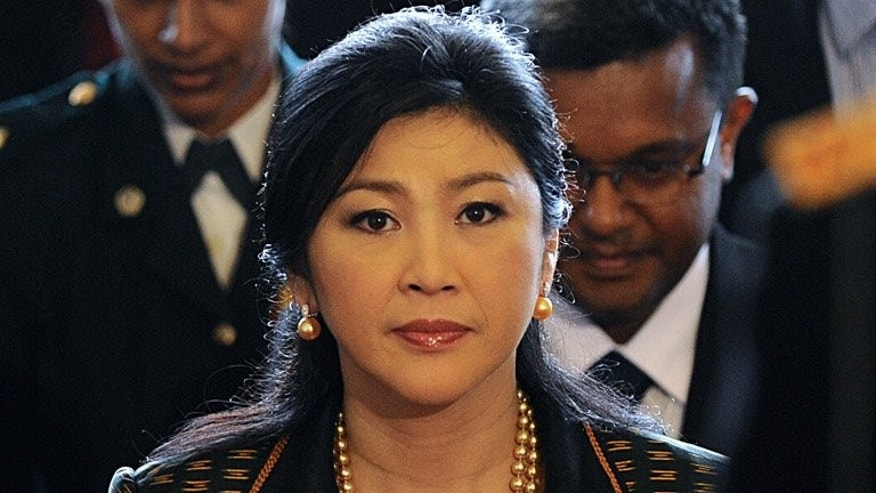 Thailand's Prime Minister Yingluck Shinawatra (pictured) on Sunday became the first woman to head the kingdom's defence ministry in a cabinet reshuffle that gives her more influence over the powerful army that ousted her brother.