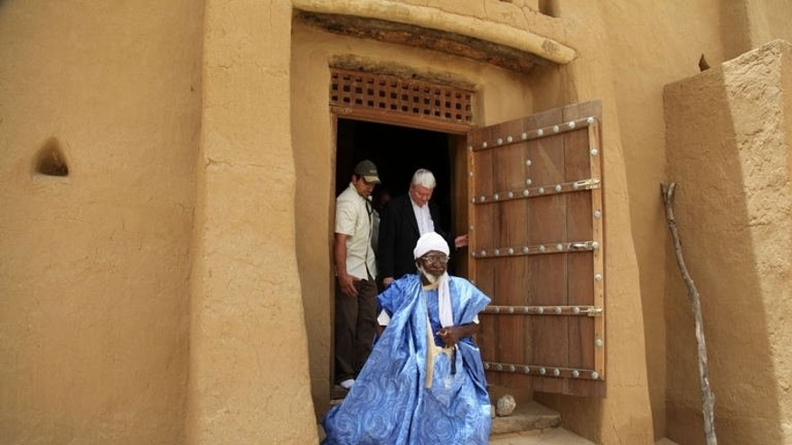 United Nations Under-Secretary-General for Peacekeeping Operations, Herve Ladsous (C) is shown around the Djinguereber mosque by its imam Abderrahmane Ben Essayouti (front) during his visit to Timbuktu on June 30, 2013.