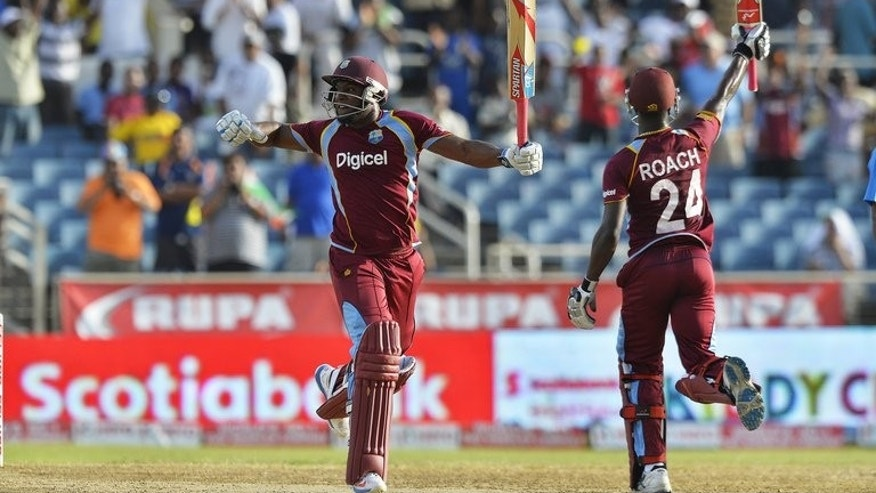 Kemar Roach and Tino Best celebrate taking the final run for West Indies to defeat India on June 30, 2013. Birthday boy Roach and last man Tino Best turned in match-saving performances at Sabina Park in Kingston.