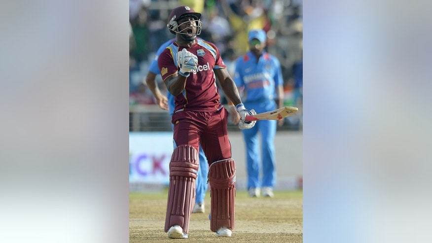 West Indies' Tino Best celebrates defeating India during the tri-nation series on June 30, 2013. Best played a key role in the victory.