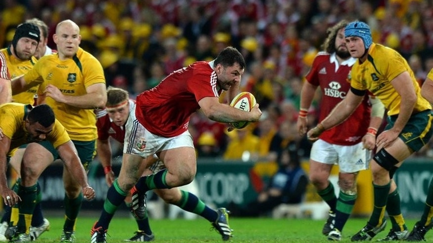 British and Irish Lions player Alex Corbisiero runs with the ball against Australia in Brisbane on June 22, 2013. Corbisiero was called up as a replacement loosehead prop and distinguished himself in the front row on his Lions Test debut in the Brisbane victory before a calf injury that ruled him out of the second Test.