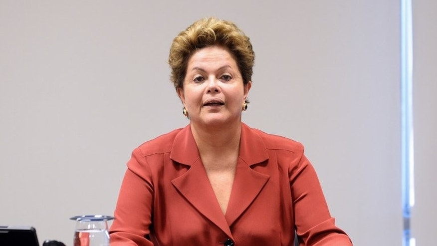 Brazilian President Dilma Rousseff is seen during a meeting with senior lawyers and lawmakers at the Planalto Palace in Brasilia on June 25, 2013. She was readying a package of political reforms designed to defuse social unrest after weeks of protests which have seen her popularity plummet.