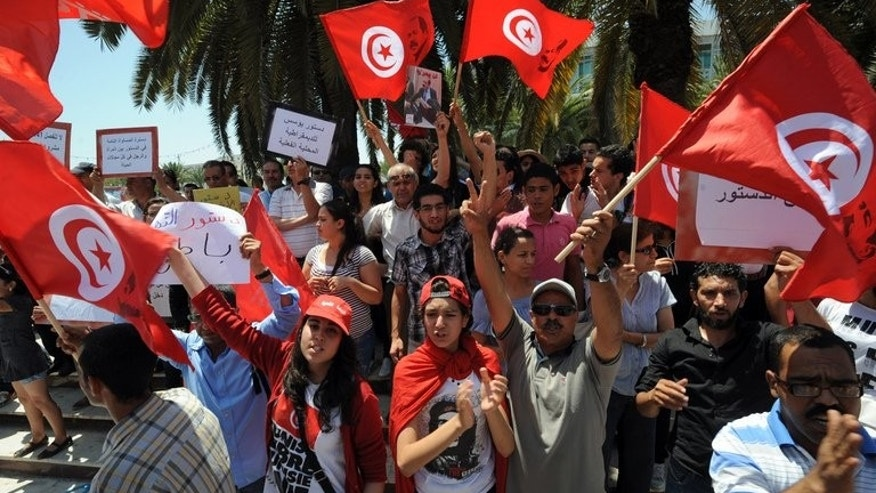 Tunisians shout slogans against the ruling Ennahda Party during a protest in front of the Constituent Assembly on July 1, 2013 in Tunis.