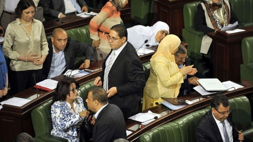Tunisian deputies interrupt the presentation by the head of the drafting committee of the draft consontitution, on July 1, 2013, in Tunis.