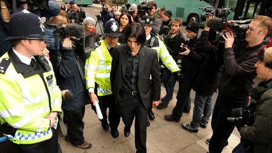 Mohammad Aamer (centre) arrives at Westminster Magistrates court in central London in March 2011. Cricket's governing body has formed a five-member committee to consider a request from Pakistan that the conditions of Mohammad Aamer's ban for spot-fixing be relaxed.