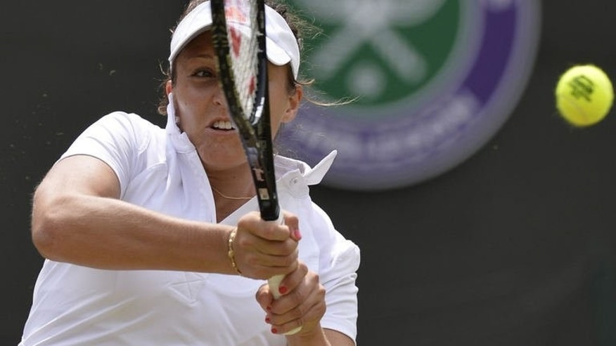 Britain's Laura Robson returns against Estonia's Kaia Kanepi during their fourth round match on day seven of the 2013 Wimbledon Championships tennis tournament in southwest London, on July 1, 2013. Britain's dreams of a first woman in the Wimbledon quarter-finals for 29 years were shattered on Monday when tearful home favourite Robson was knocked out in straight sets by Kanepi.