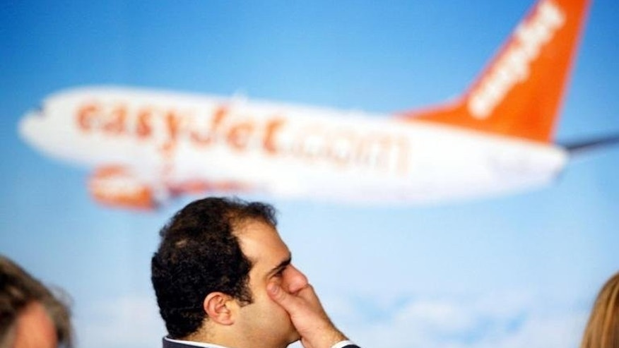 Stelios Haji-Ioannou pictured during a press conference announcing his resignation as chairman of EasyJet in London on November 26, 2002. Haji-Ioannou, the founder and biggest shareholder of the British no-frills airline , said on Monday that he would vote against the board's recent agreement to buy 135 Airbus single-aisle A320 passenger planes.