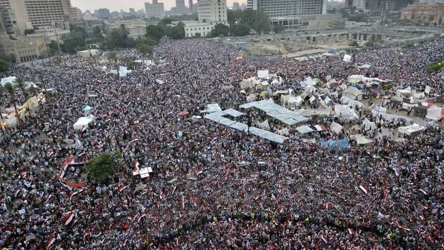 Hundreds of thousands of Egyptian demonstrators gather in Cairo's landmark Tahrir Square during a protest calling for the ouster of President Mohamed Morsi on July 1, 2013. Egypt's presidency on Tuesday rejected an army ultimatum threatening to intervene if Morsi did not meet the demands of the people, raising the stakes in the country's political crisis.