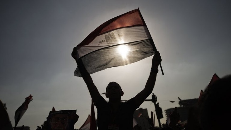 An Egyptian protester waves his national flag as thousands celebrate on July 1, 2013 in Cairo's landmark Tahrir Square.