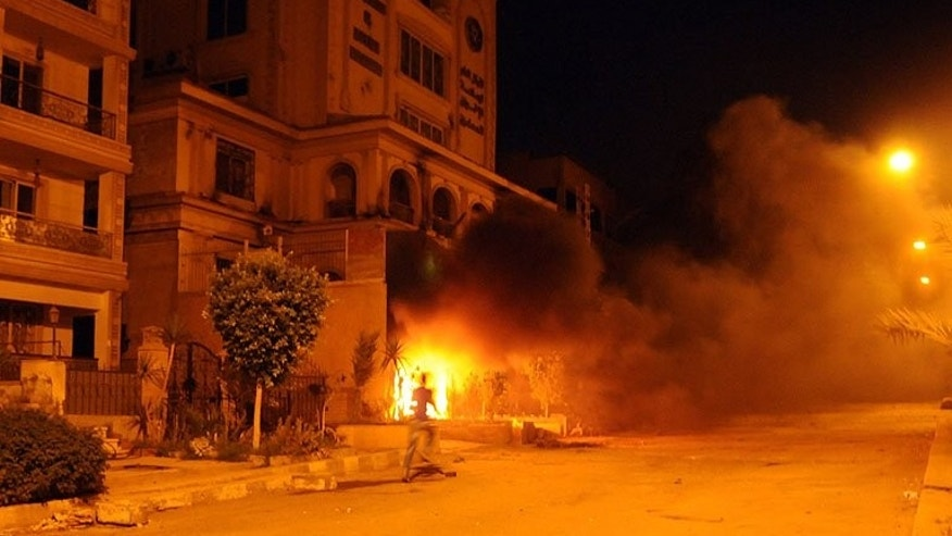 Egyptians opposed to President Mohamed Morsi set fire to the Muslim Brotherhood headquarters in the Almoqatam district of Cairo, on June 30, 2013.