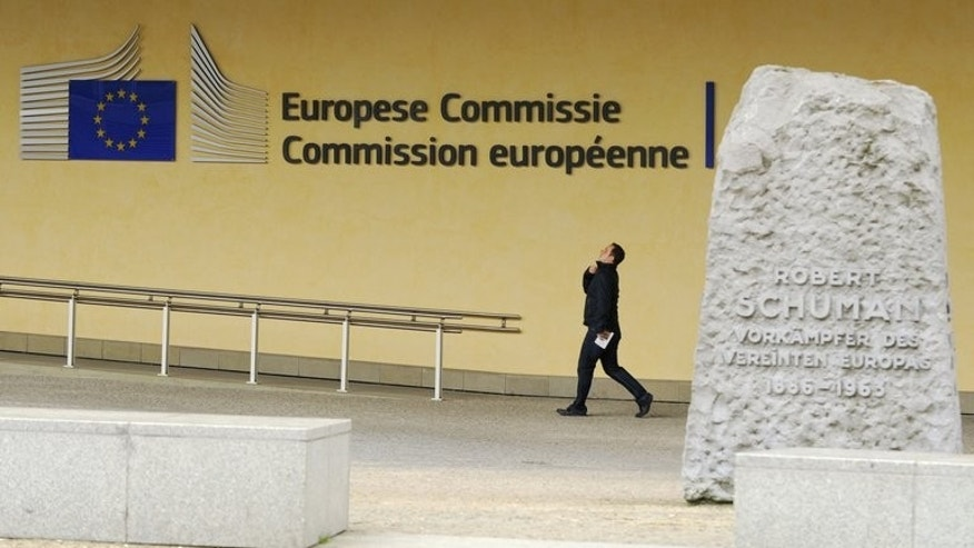 A man walks in front of the Charlemagne building at the European Union (EU) headquarters in Brussels on June 10, 2013. A long-awaited trade deal between the European Union and the United States could be in jeopardy over allegations that Washington bugged EU offices, European Justice Commissioner Viviane Reding warned.