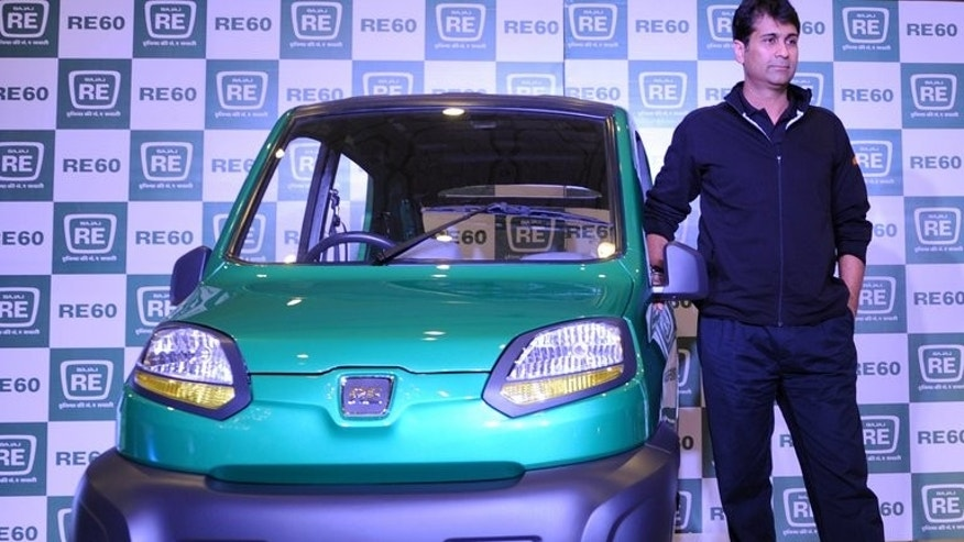 Bajaj Auto managing director Rajiv Bajaj with the company's RE60 in New Delhi last year. Fifteen Indian companies including the Bajaj group said they had filed applications for new banking licences before a deadline on Monday, in the first opening of the market in more than a decade.