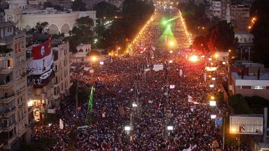 Hundreds of thousands of Egyptian demonstrators gather outside the presidential palace in Cairo during a protest calling for the ouster of President Mohamed Morsi on June 30, 2013. Five people have died in the massive demonstrations reminiscent of the 2011 revolt which ultimately paved the way to his leadership.