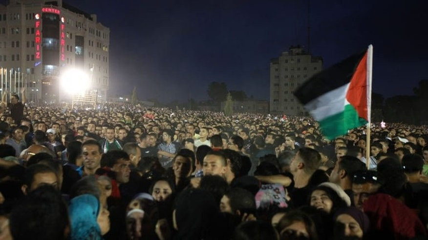 "Thousands of Palestinians attend a concert by the winner of ""Arab Idol"" Mohammed Assaf in the West Bank city of Ramallah on July 1, 2013."