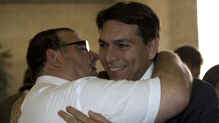 Israeli Deputy Defence Minister Danny Danon (R) is greeted by a supporter during the Likud party election in Jerusalem on June 30, 2013. Hardliners in Israeli Prime Minister Benjamin Netanyahu's Likud were elected into key positions in the party's governing institutions early Monday, in a move that could create difficulties on making concessions to the Palestinians.