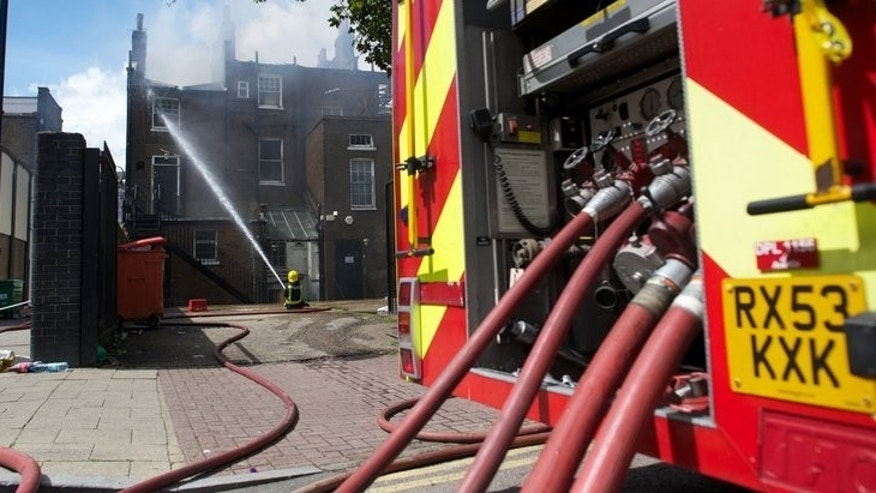 File picture shows firefighters trying to extingush a blaze in north London on August 7, 2011. More than 200 firefighters were on Monday battling a major blaze at a British recycling plant after 100,000 tonnes of paper and plastic caught fire, sending a plume of smoke rising into the sky which could be seen for miles around.