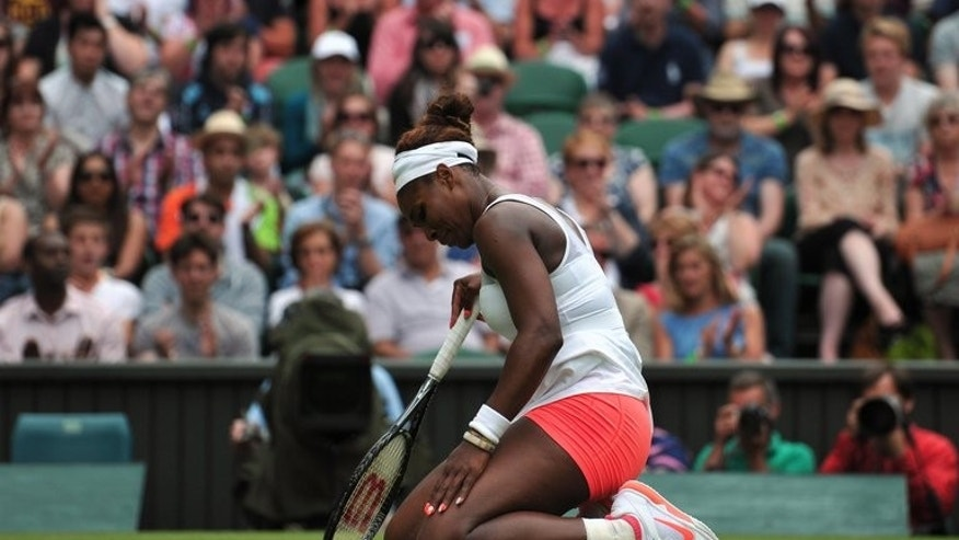 Serena Williams kneels on the court during her match against Sabine Lisicki at Wimbledon on Monday. Since an embarrassing first round loss against Virginie Razzano at last year's French Open, Williams had simply been unstoppable, winning 77 of her 80 matches and collecting the Wimbledon, US Open, French Open and Olympic titles in the process.