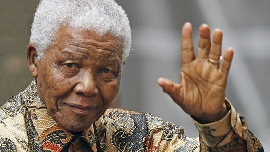 "File picture taken on August 28, 2007 shows former South African president Nelson Mandela waving to the media as he arrives outside 10 Downing Street in London. Mandela remains in a ""critical but stable"" condition, South Africa's presidency said Monday, more than three weeks after the anti-apartheid hero was hospitalised with a recurring lung infection."