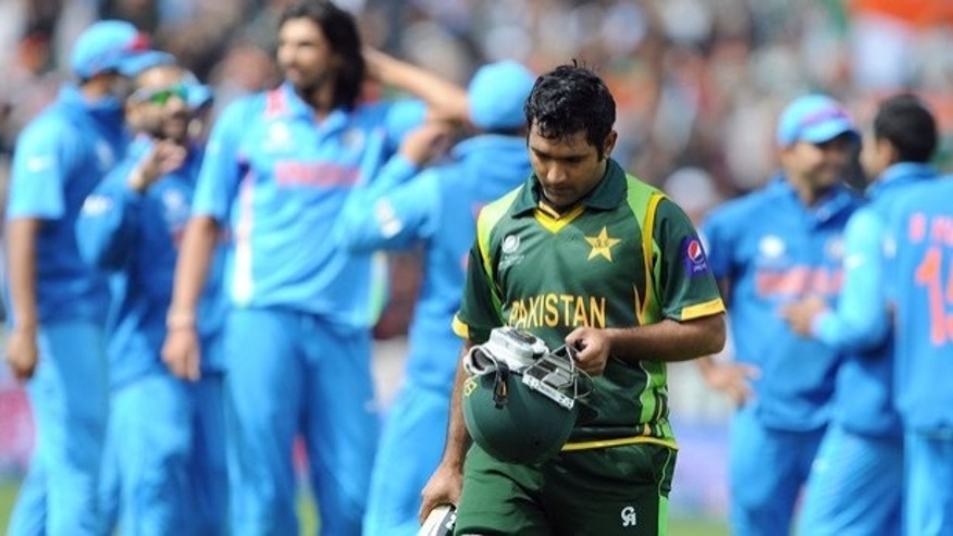 Asad Shafiq leaves the field after losing his wicket against India at Edgbaston on June 15. Shafiq scored just 41 runs for Pakistan in three Champions Trophy matches.