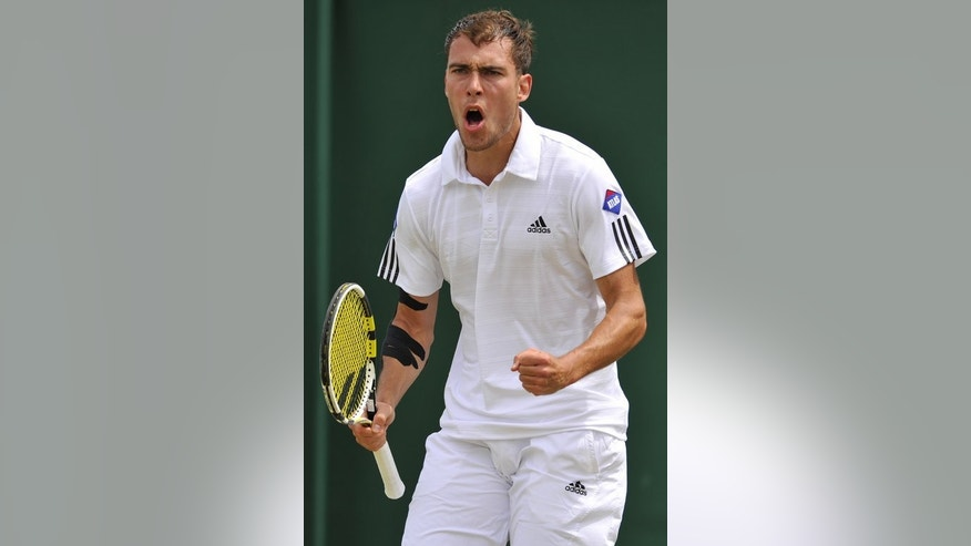 Jerzy Janowicz celebrates winning a game against Jurgen Melzer at Wimbledon on July 1, 2013. Janowicz, the 24th seed, defeated 31-year-old Jurgen Melzer, who was hoping to become the first Austrian man to reach the last eight.