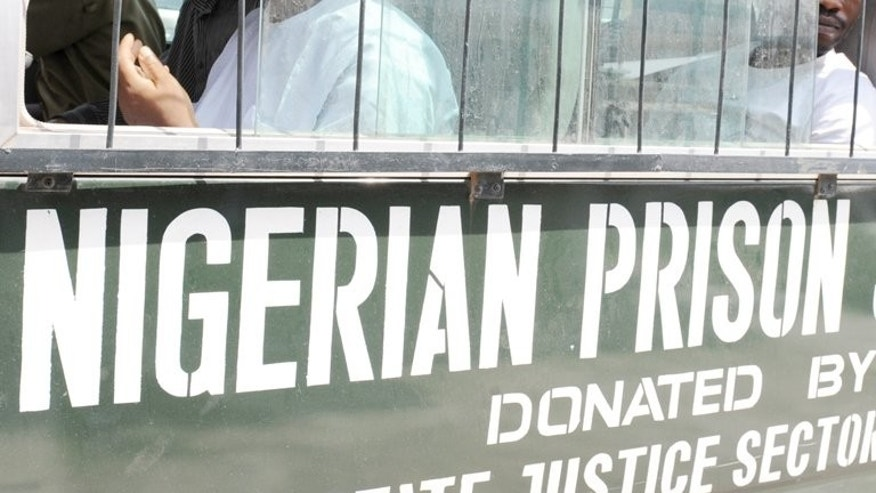 Prisoners sit on March 7, 2011 in a bus headed to prison from Lagos. Nigerian authorities have rearrested 49 of 175 prison inmates who escaped from their southwest city jailhouse after it was attacked by gunmen, a spokesman of the Nigerian Prisons Service said on Monday.