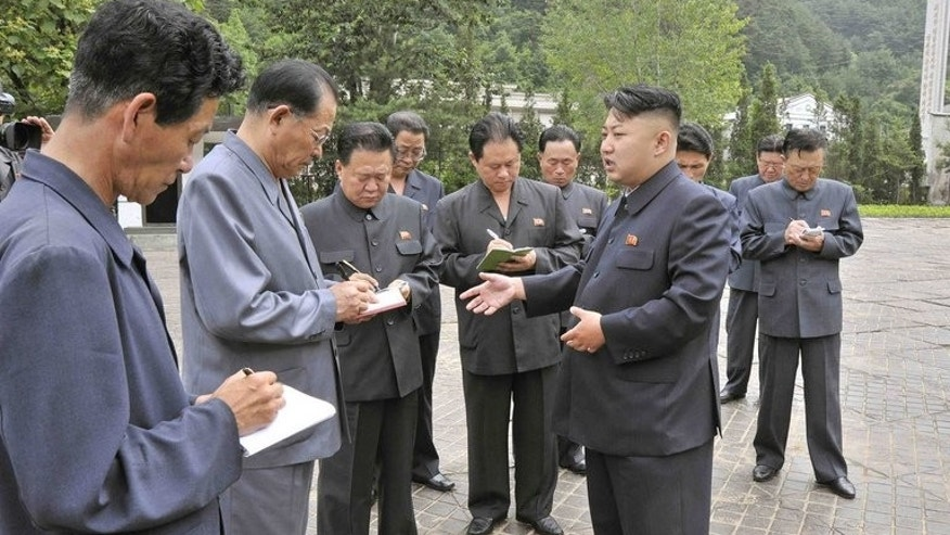 This undated photo, released by North Korea's official Korean Central News Agency (KCNA) on June 30, 2013, shows North Korean leader Kim Jong-Un (C) inspecting the Sinhung Machine Factory in South Hamgyong province.