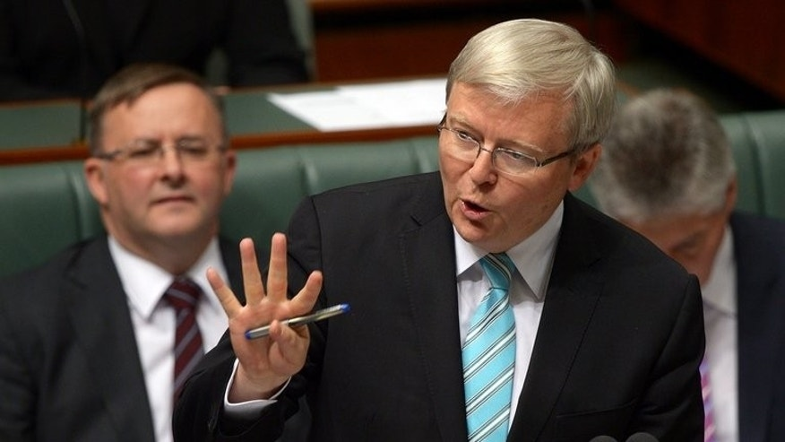 Australian prime minister Kevin Rudd (C) speaks in parliament's House of Representatives in Canberra on June 27, 2013.