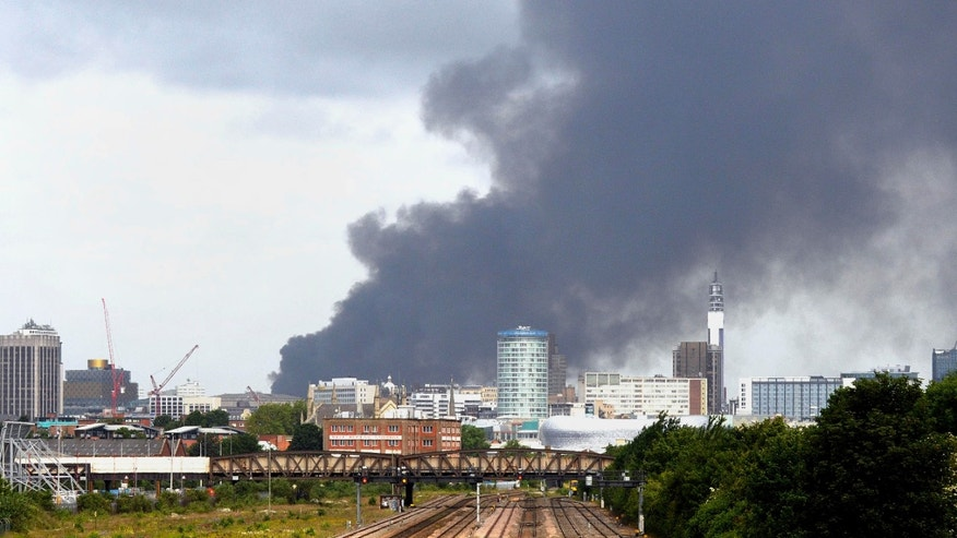 July 1, 2013 - Smoke rises over the  skyline of Birmingham England following a fire at a plastics recycling plant Monday .