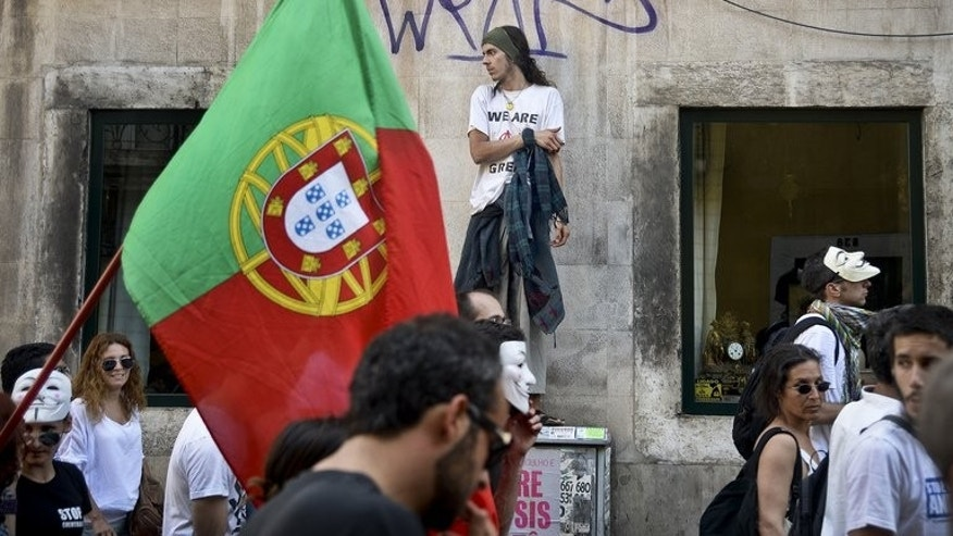 Protesters take part in a demonstration against the government's austerity measures during a general strike in Lisbon on June 27, 2013.