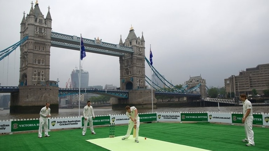 Shane Watson (right) joins in a cricket match on a barge in the River Thames on June 20. Watson will open the batting for Australia in next week's first Ashes Test, in partnership with Chris Rogers (left).