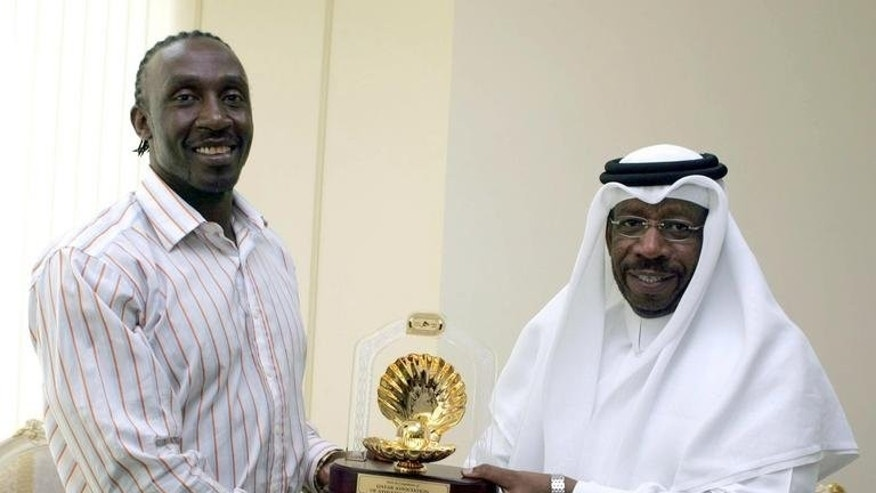 Dahlan al-Hamad (right) presents an award to British sprinter Linford Christie in Doha in 2005. Hamad was elected president of the Asian Athletics Association by two votes in a hotly-contested election before the Asian track and field championships which open in the Indian city of Pune on Wednesday.