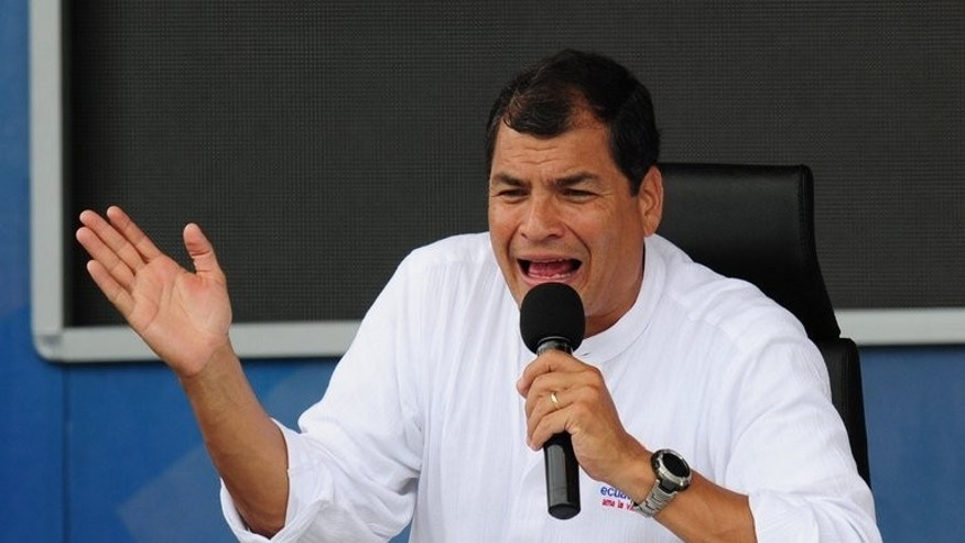 Ecuadorean President Rafael Correa, pictured June 29, 2013, said Edward Snowden's bid for sanctuary in Russia could resolve a standoff with the United States.