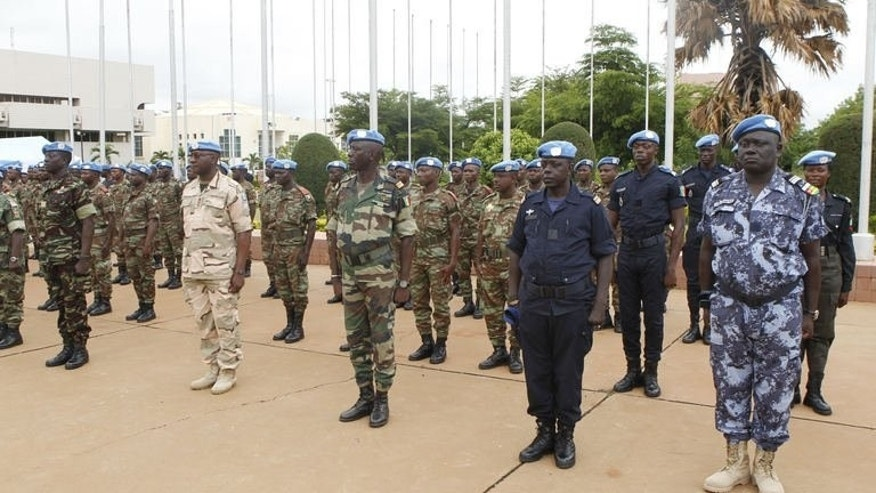 United Nations peacekeepers stand to attention during a transfer of duties ceremony from African troops in Mali in the capital Bamako on July 1, 2013. United Nations peacekeepers took over security duties from African troops in Mali on Monday with a mission to ensure stability in the conflict-scarred nation just four weeks ahead of planned elections.