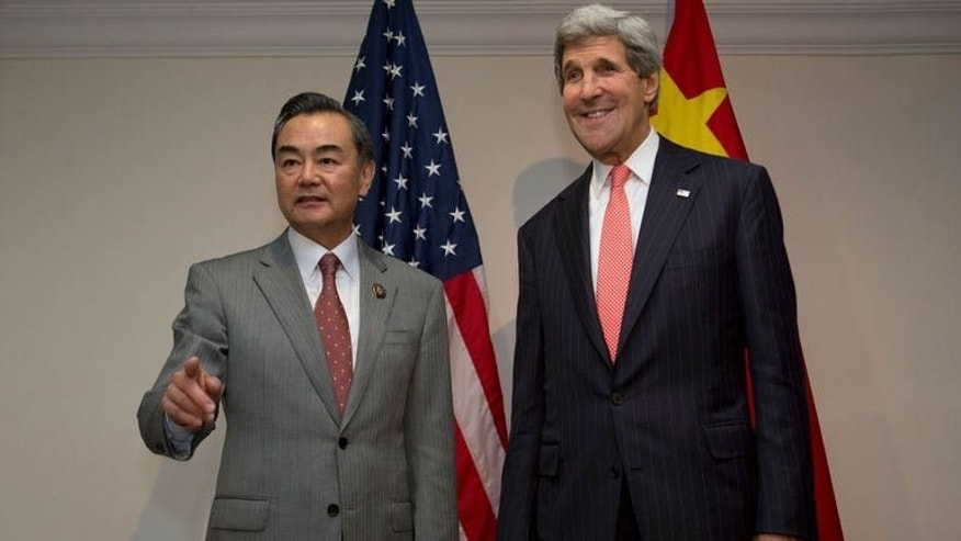"China's Foreign Minister Wang Yi (left) meets with US Secretary of State John Kerry at the ASEAN meeting in Bandar Seri Begawan, Brunei, on July 1, 2013. Kerry has nudged China to agree a code of conduct to prevent clashes in the South China Sea after the Philippines accused Beijing of a ""massive"" military build-up."