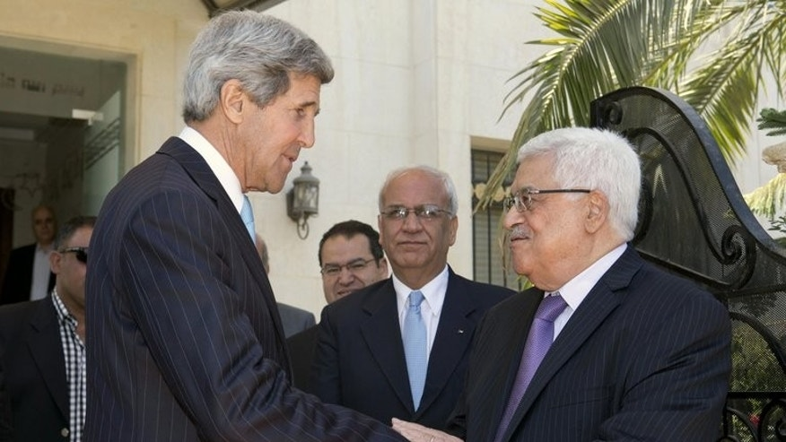 "US Secretary of State John Kerry (left) bids farewell to Palestinian president Mahmud Abbas after their second meeting in the Jordanian capital Amman, on June 29, 2013. Abbas says Kerry had made ""useful and constructive proposals"" during his four-day visit last week and said he was ""optimistic"" about the outcome."