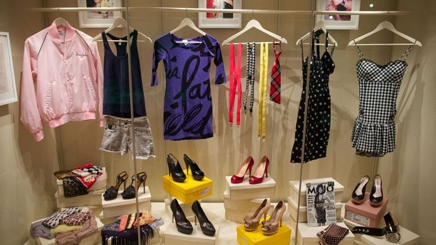 """Clothes and accessories worn by late British singer Amy Winehouse are displayed at the """"Amy Winehouse A Family Portrait"""" exhibition at the Jewish Museum in North London on July 2, 2013."""
